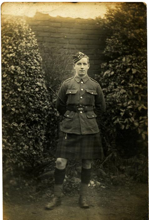 ADX/375/13 Photograph of a soldier in a kilt.