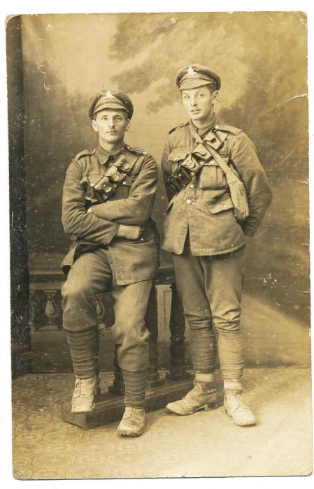 ADX/375/1 Postcard, sent from Ypres, of a studio portrait of two soldiers in uniform. Back has a message of congratulations signed 'Tommy'. 14 September 1917
