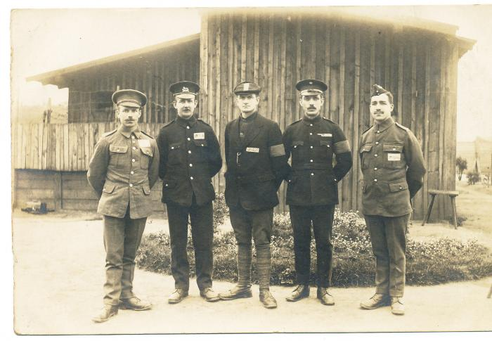 ADX/375/7 Photograph of five soldiers in a prisoner of war camp.